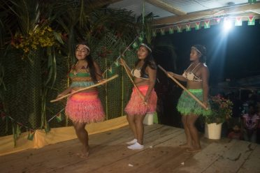 A group performing the farmer's dance