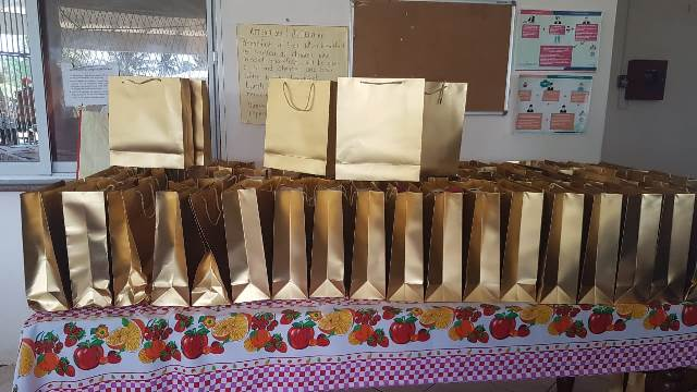 The gift bags which were handed over to the girls containing hair care and other items.