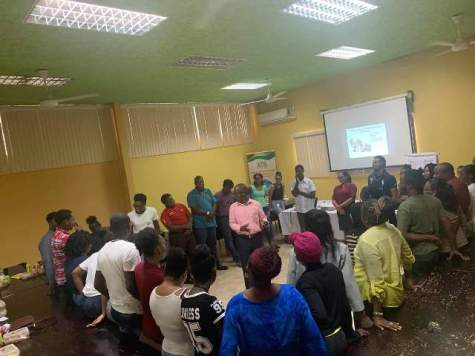 Workshop facilitator Will Campbell in the centre as he involves the youths in a group activity