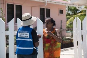 CDC Volunteer distributing sandbags to residents.