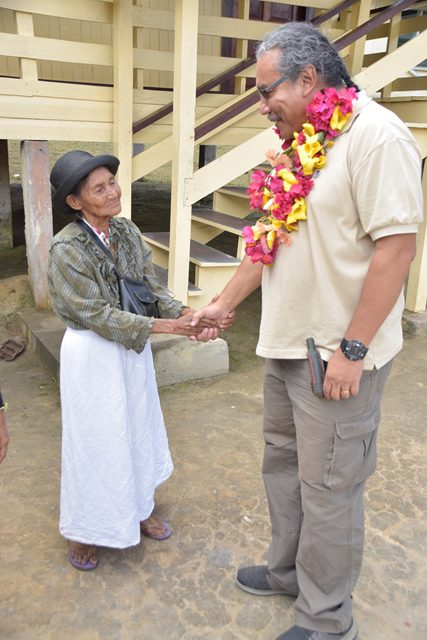 Ministerial Advisor in the Ministry of Indigenous Peoples' Affairs and Member of Parliament (MP), Hon. Mervyn Williams interacting with a resident.