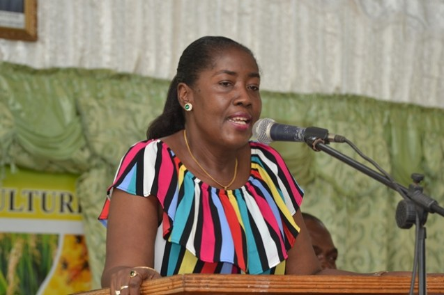 Minister within the Ministry of Agriculture of Agriculture Valerie Adams-Yearwood presenting the benefits of Agriculture to the students gathered.