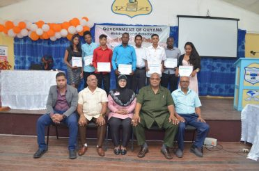 Officials from the Board of Industrial Training, the Essequibo Institute along with REO Denis Jaikarran [seated second left] and BIT Vice-Chairman, Donald Ainsworth [seated second right] along with some of the graduates.