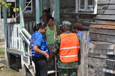 CDC representatives distributing supplies to a resident.