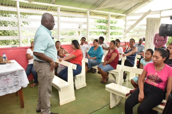 Minister of Citizenship, Hon. Winston Felix engaging residents of Thomas Hill.