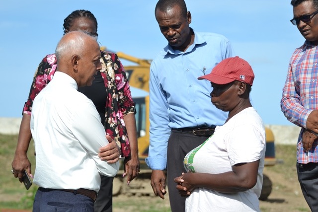 Minister of Communities, Hon. Ronald Bulkan interacting with one of the residents.