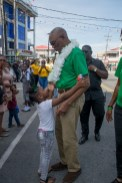 A little resident is eager to greet His Excellency, President David Granger.