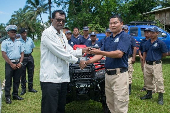 Minister of Public Security Khemraj Ramjattan hands over the keys to the ATV to Chairman of the White Water CPG Cleveland De Souza