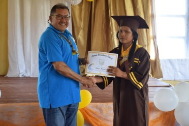 Minister of Indigenous Peoples' Affairs, Hon. Sydney Allicock handing over a certificate.