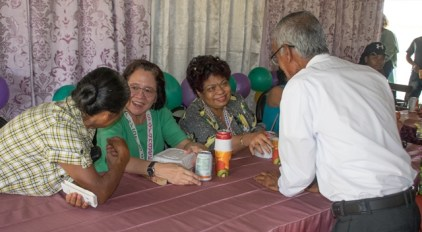 Senior residents of Paramakatoi interacting with First Lady, Her Excellency, Sandra Granger and Minister of Social Protection, Hon. Amna Ally.