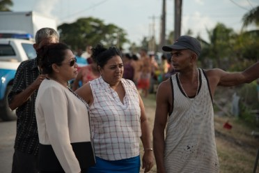 Minister of State, Hon. Dawn Hastings-Williams, listens top concerns of residents of Zeelught, during the distribution of hampers on Tuesday.