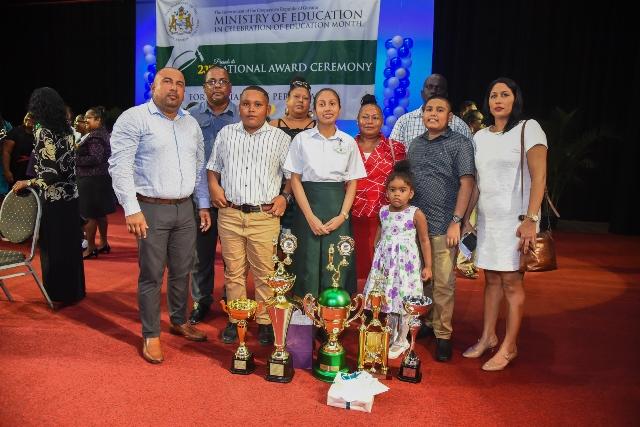 CSEC Caribbean Top Performer, Riana Toney surrounded by family.