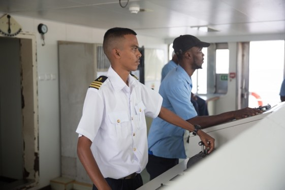 [in the foreground] Capt. Navendra Singh aboard the MV Sabanto.