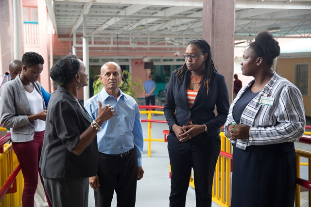 Minister of Public Service, Hon. Tabitha Sarabo-Halley being briefed by the staff.