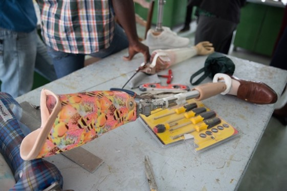 Prosthetic limbs being manufactured by the facility.