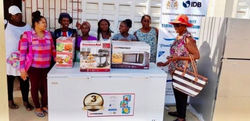 Beneficiaries from the Kildonan Community Action Council Group with the donation of the kitchen appliances.