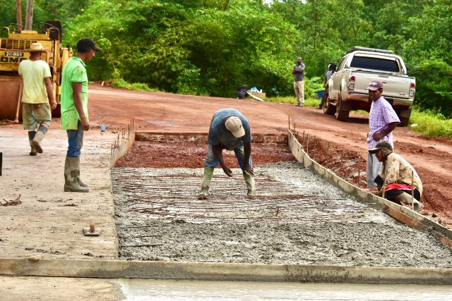 Workers completing portion of road to Kumaka Bridge.