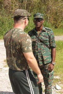 Director-General (DG) of the CDC, Lieutenant Colonel Kester Craig interacting with one of the Brazilian officers.