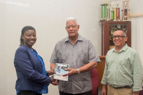 [In the photo, from left to right] Country Manager of WWF Guianas, Aiesha Williams hands over the Artisanal Fishery Management Plan to Minister of Agriculture, Hon. Noel Holder and Chief Fisheries Officer within the Department of Fisheries, Denzil Roberts.