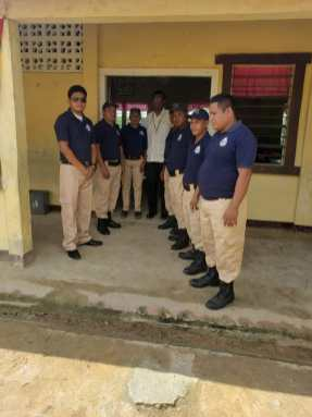 Minister of Public Security, Hon. Khemraj Ramjattan and some members of the White Water's Community Policing Group (CPG).