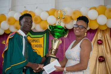 Valedictorian, Tyrese Wright receiving his award.
