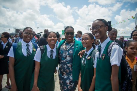 Minister of Education, Hon. Dr. Nicolette Henry shares a photo op with some students from The Bishops' High School.