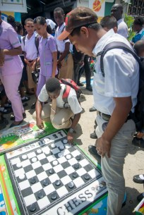 Students engaged in a game of checkers at the exposition.