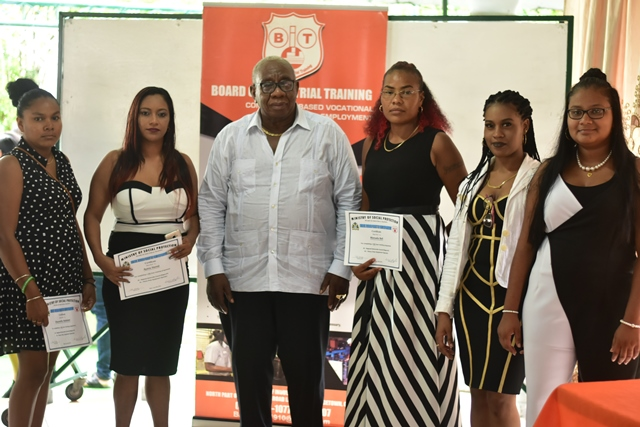 Chairman, of the Board of Industrial Training (BIT), Clinton Williams with some of the graduates.