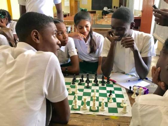 Students of Fort Wellington Secondary School learning how to play the game of chess.