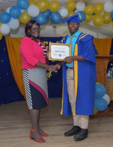 Valedictorian, Emmanuel Harry from the Headmistress of Vreed-en Hoop Secondary School Sharon Savory