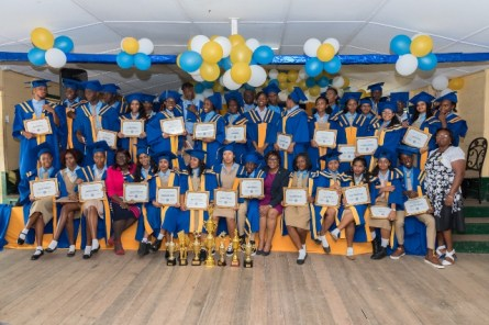 Minster of Public Telecommunications, Hon. Catherine Hughes and Headmistress Sharon Savory with the 2019 graduating class of Vreed-en Hoop Secondary School