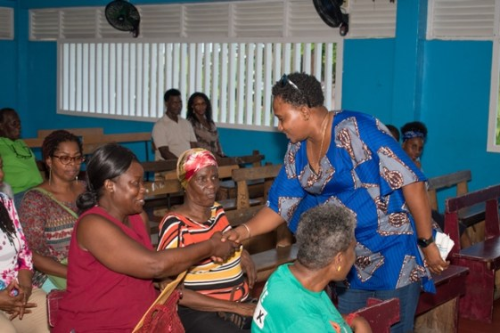 Minister within the Ministry of Communities, with responsibility for Housing, Hon. Annette Ferguson meets with the residents gathered for the meeting.