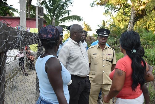 Minister of Citizenship, Hon. Winston Felix engaging residents in Bagotville on Thursday.