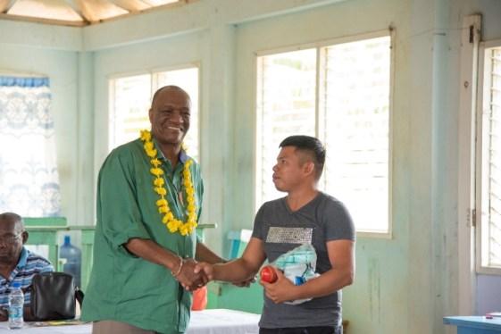 Director-General (DG) of the Minister of the Presidency, Joseph Harmon donating sport gear.