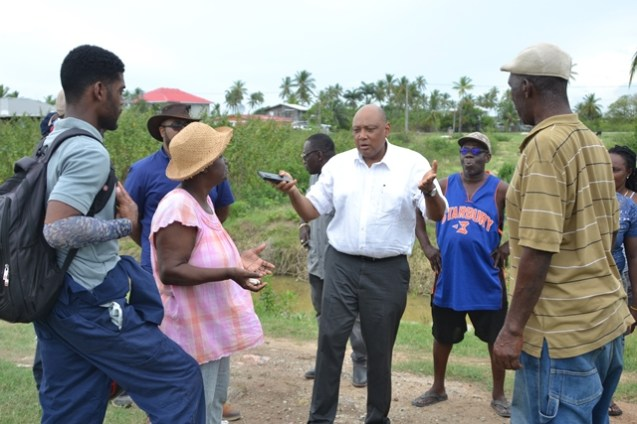 Minister of Natural Resources, Hon. Raphael Trotman on the ground in Buxton/Friendship visiting the farms with the farmers.