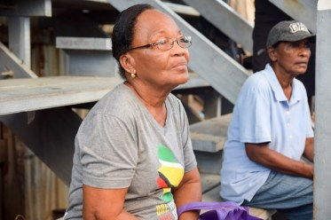 A resident listens to Minister of Communities, Hon. Ronald Bulkan.