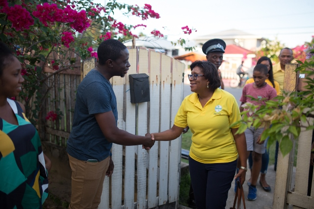 Minister of Public Telecommunications, Hon. Catherine Hughes greeting Kingelly residents.