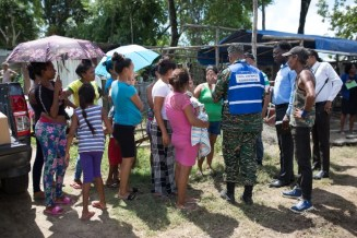 An official from the CDC briefing the residents of Golden Grove, EBD.