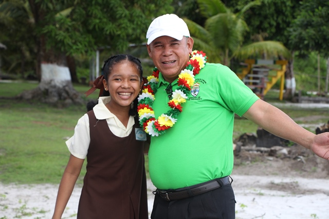 Minister Norton and one of the students that greeted him on his arrival to the village of Capoey