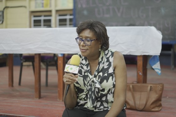 Minister of Public Telecommunications, Hon. Catherine Hughes speaking to the residents of Uitvlugt, West Coast of Demerara (WCD).