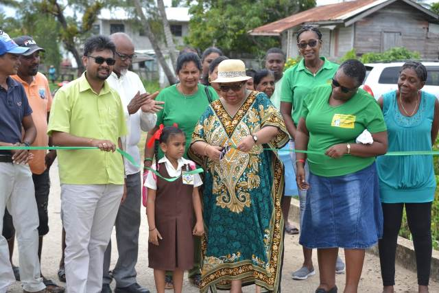 Minister of Social Protection, Hon. Amna Ally and His Worship the Mayor of Georgetown, Pandit Ubraj Narine, commissioning the $314M sea defence project at Endeavour in the Essequibo Island of Leguan.