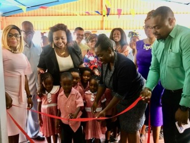 Students of Rose Hall Nursery cut the ceremonial ribbon to declare the facility opened. Also, in the photograph, members of Root and Friends of Rose Hall, Town Clerk Natasha Griffith [far right] and Edison Jefford, Manager for Community Development and Social Management [left].