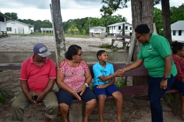 Minister within the Ministry of Communities, with responsibility for Housing, Hon. Annette Ferguson interacting with residents of Santa Aratak.
