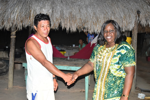 Minister of Foreign Affairs Dr. Karen Cummings is greeted by Tosaho of Yurong Paru, Rovain Francis