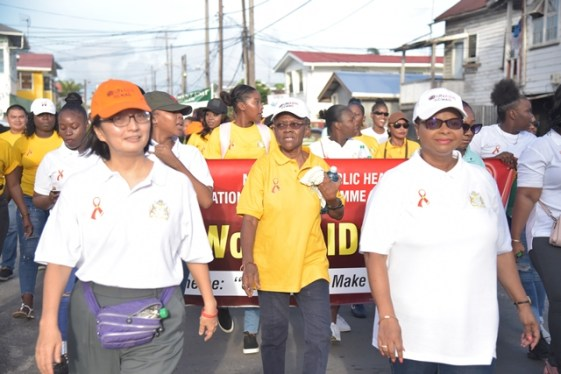 Minister of Public Health, Volda Lawrence and UN Resident Coordinator and UNDP Resident Representative for Guyana, Mikiko Tanaka leading this year's World Aids Day walk.