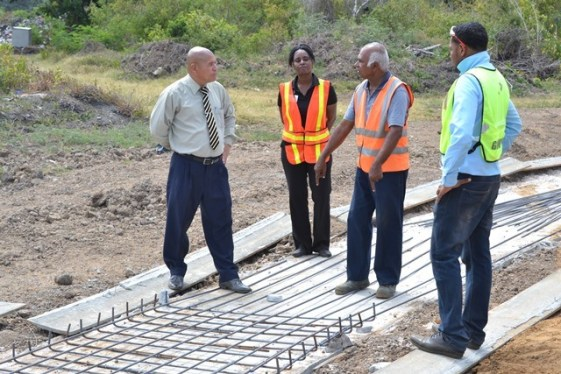 ????????????????????????????????????Project Manager Lionel Kandasammy explaining the ongoing works of the synthetic track at the Burnham Park in New Amsterdam, to Minister of Social Cohesion Dr. George Norton during a site visit in April 2019.