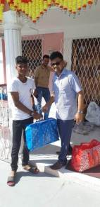 Mayor of Georgetown, Pandit Ubraj Narine distributing hampers to residents of Tuschen, Region 3