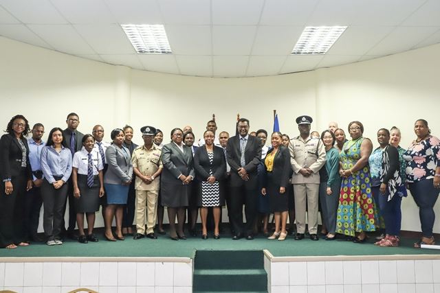 Minister of Public Security and Chairman of the Ministerial Taskforce for Trafficking in Persons Khemraj Ramjattan (centre), to his right Chief Justice (a.g) Roxane George, (left) Attorney-at-Law and Legal Consultant Diana Shaw and Commissioner of Police Leslie James along with other key stakeholders