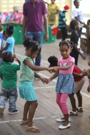 Scenes from Minister of Education Dr. Nicolette Henry's Christmas parties in East Berbice