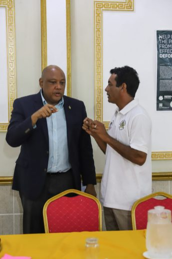 Minister of Natural Resources, The Hon. Raphael Trotman speaks with NTC Chairman, Nicholas Fredericks, at the opening of Tuesday's Financial Management Workshop